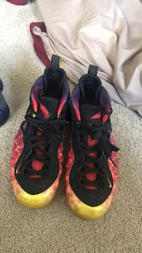 pair of black-and-red Nike Foamposite Red Lion, 17356