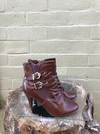 pair of women's brown leather 2-buckled booties