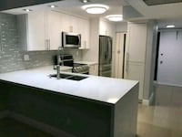 white and black wooden kitchen cabinet Hialeah, 33018