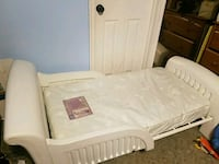white metal toddler bed frame with white mattress Moore