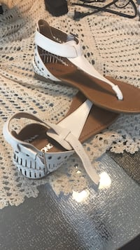 pair of brown-and-white thong flat sandals
