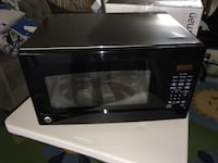 MOVING SALE: GE Microwave LIKE NEW Arlington, 22204