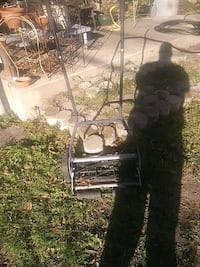 black and gray reel mower 1359 mi
