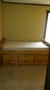 Two twin size beds with drawers