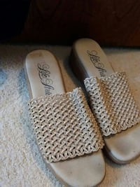 pair of beige woven slip-on sandals