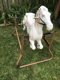 White and brown rocking horse 539 km