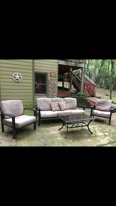 Outdoor living room. Includes, sofa, chairs, table and cushions.