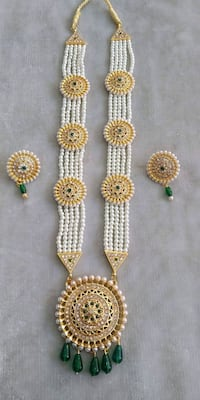two gold and silver necklace