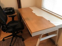 IKEA office set up. Includes sturdy art desk, matching cabinet and ergonomic chair