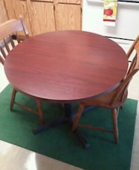 round brown wooden table with four chairs dining set Kokomo, 46901