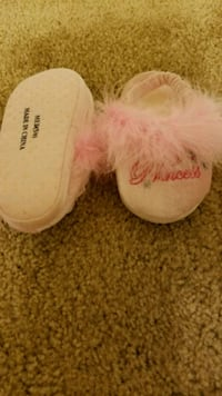 pair of pink UGG sheepskin boots Fort Meade