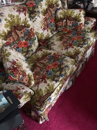 Brown and red floral fabric sofa chair null