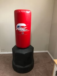 red and black Wave Master free standing heavy bag Calgary, T3K 0P3