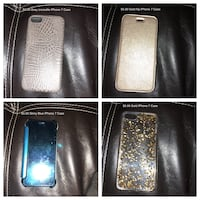 four assorted-color smartphone cases