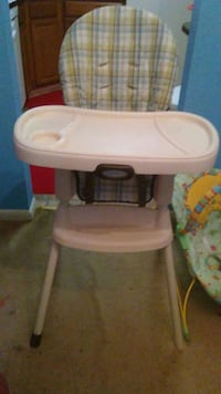 baby's white and green high chair 9 mi