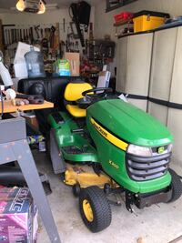 John Deere X300 with double bagger Cape Coral, 33914
