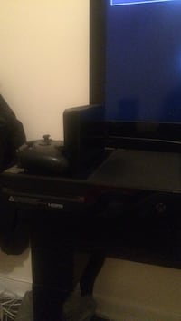 Black xbox one console with controller and a 3tb external harddrive
