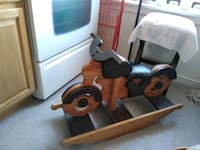 brown and black wooden rocking horse Bronx