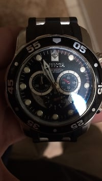Black invicta watch (face only)