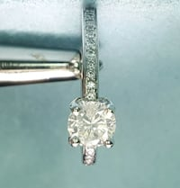 Round solitaire diamond ring with diamond accents Macon