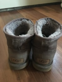 Pair of gray ugg boots they are used only one winter still good taking best offer