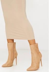 Pair of beige suede pointed toe stiletto booties Vancouver, V6E 3M1
