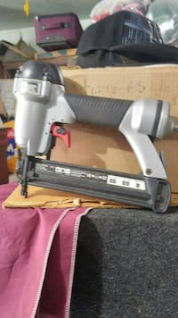 gray and black nail gun