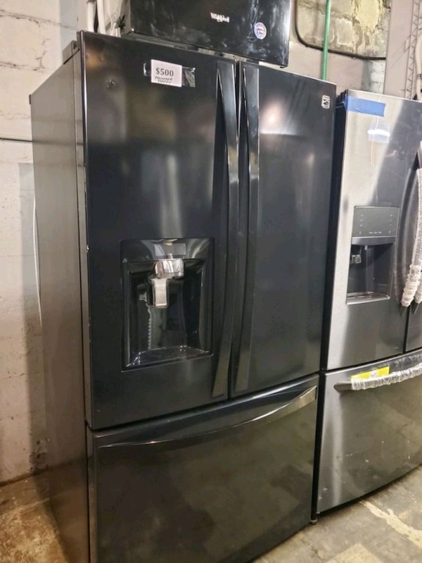 Kenmore French doors fridge in excellent condition 84f70b4b-b2a9-42e1-8990-110ab701bf96