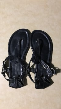 pair of black leather thong sandals