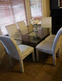 rectangular brown wooden table with six chairs din Tucson, 85748