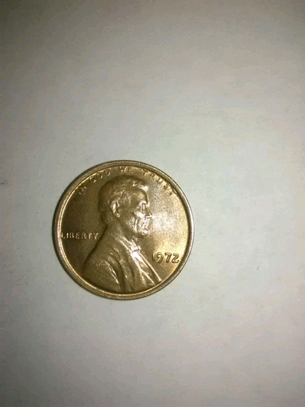 round silver Liberty coin in case