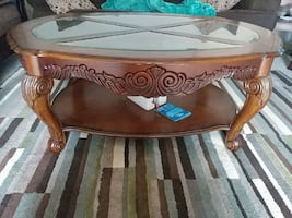 brown wooden oval glass panel table