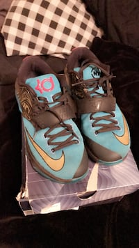 Pair of gray-and-blue nike basketball shoes