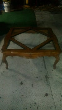 brown wooden framed glass-top table 934 mi