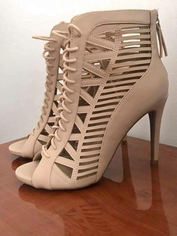 pair of white leather open-toe gladiator heels