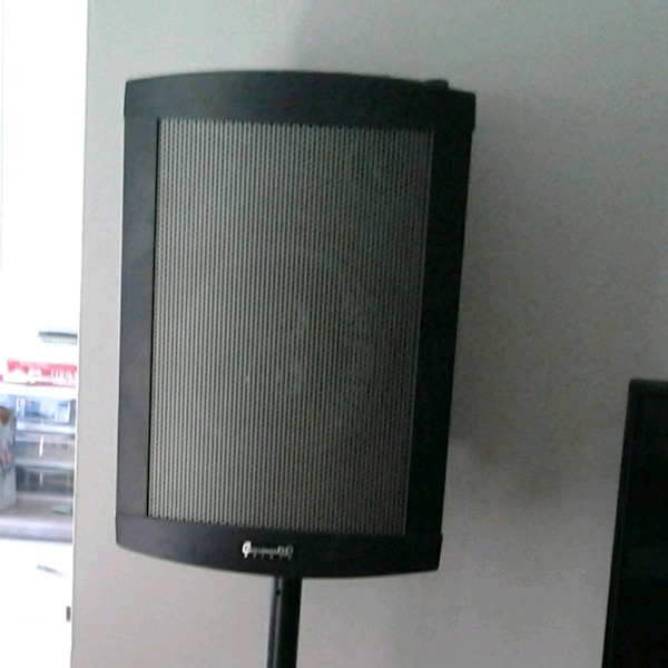 Portable speaker with stand