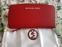 New red wallet, never used   Toronto, M2M 4B9