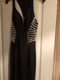 Prom or evening dress Size 6 Small Color Black and Silver  In a great condition  Worn once for graduation  Pick up or can deliver  Bought for over 500$ Asking price $ 160.00 See more pictures
