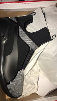 unpaired black and gray high-top athletic shoe with box