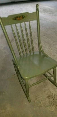 Antique pressed back rocking chair 388 mi
