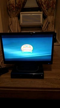 black flat screen computer monitor and dvd player