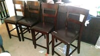 two brown wooden framed black leather padded chairs Phoenix, 85028