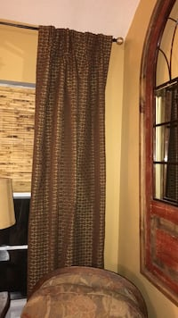 Custom made pinch pleated drapes. 4 panels in a thick heavy lined fabric. Colors are a dark greenish grey with gold and a warm red. Will sell separately  Helena, 35080