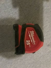 red and black Milwaukee cordless power tool Aurora, 80010