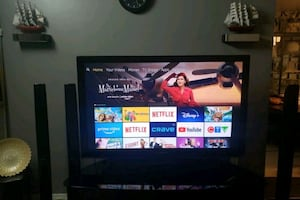 """Plasma 60"""" TV with blue ray DVD player and surround sound system"""