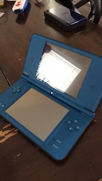 blue Nintendo DS with game cartridge Poway, 92064