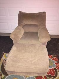 brown suede sofa chair with ottoman