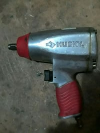 silver and red Husky pneumatic impact wrench Winder, 30680