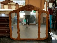 brown wooden frame wall mirror Cibolo