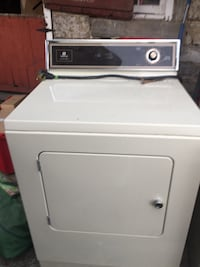 classic white and black Maytag front-load washing machine 86 mi